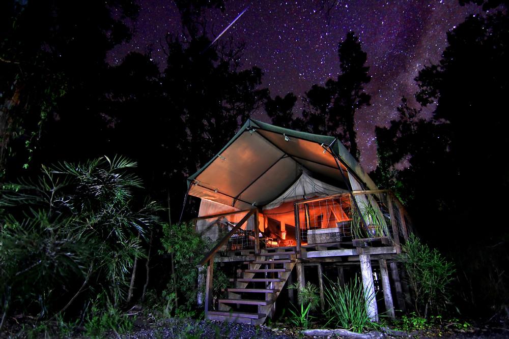 Janie Robinson - Paperbark Camp safari tent beneath a starry sky, New South Wales, Australia