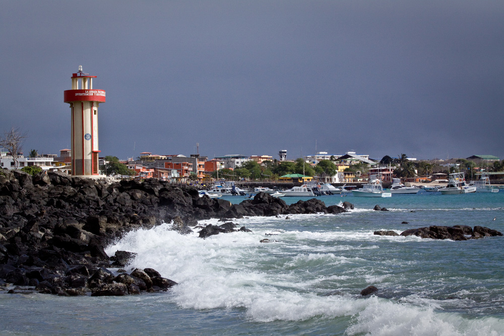 Lighthouse and coastland in Mann Beach, San Cristobal, Galapagos Islands, Ecuador