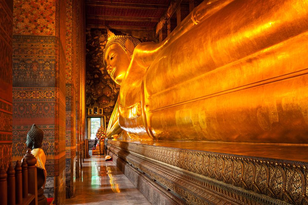 Reclining Buddha gold statue in Wat Pho, Bangkok, Thailand