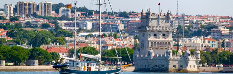 Yacht passing Belem Tower in Belem district, Lisbon, Portugal