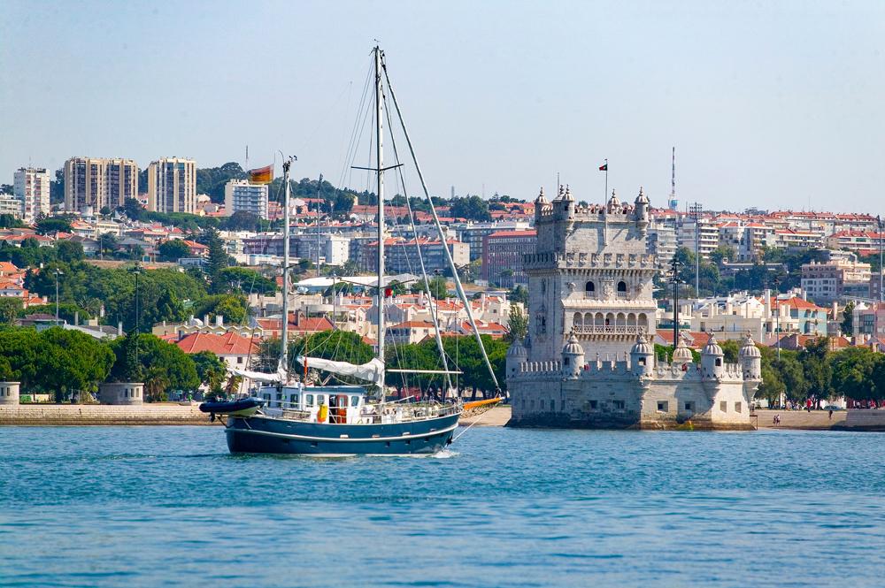 Yacht passing Belem Tower in Belem district, Lisbon, Portugal