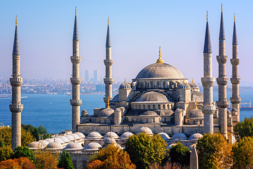 Blue Mosque (Sultanahmet Camii) with Bosphorus Sea and Asian side skyline, Istanbul, Turkey