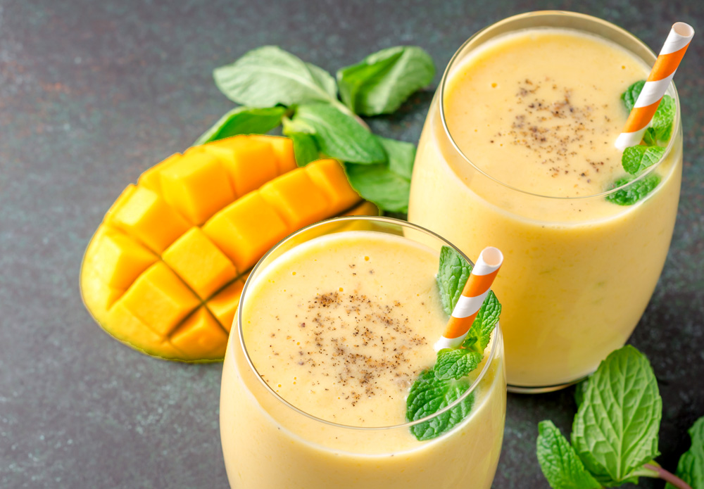 Mango lassi with mint leaves, India