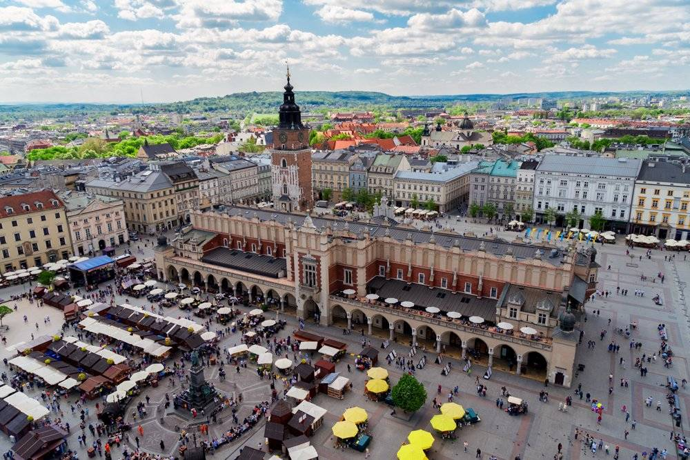 Market Square with Cloth Hall and City Hall Tower in Krakow, Poland