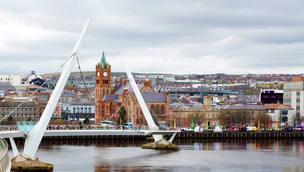 Peace Bridge over the River Foyle and Guildhall, Derry (Londonderry), Northern Ireland