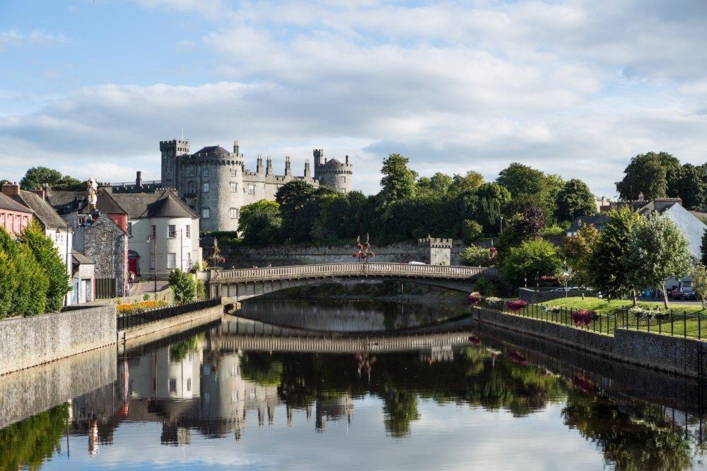 Riverside view of Kilkenny Castle, town and bridge, Ireland