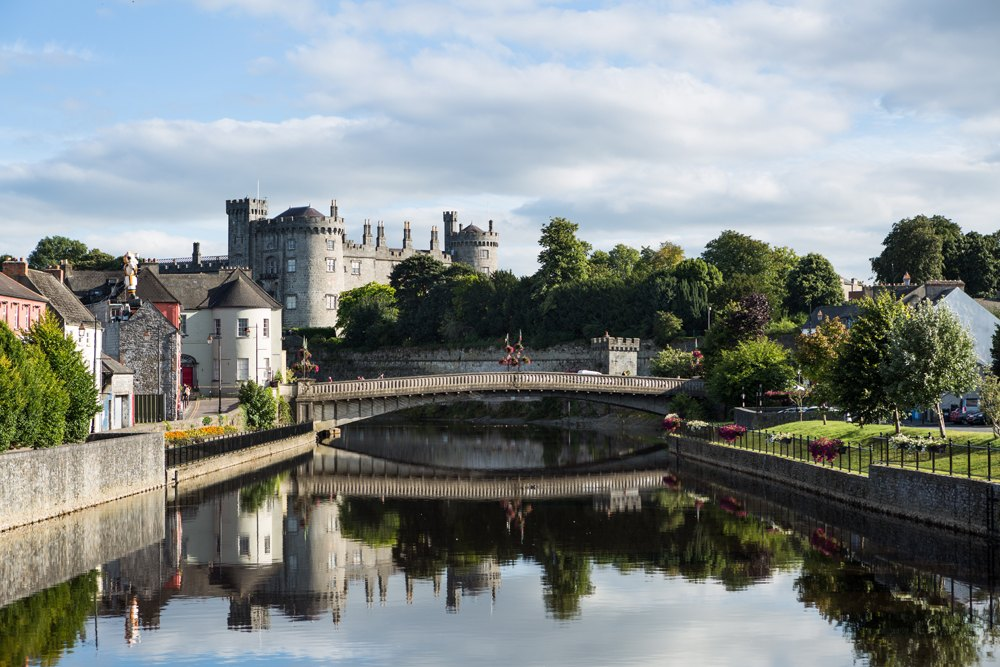 Riverside view of Kilkenny Castle, town and bridge, Ireland