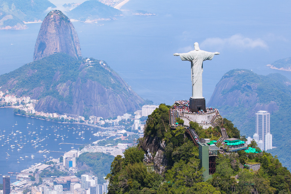 Aerial view of Rio de Janeiro with Christ the Redeemer statue, Corcovado Mountain, and Sugarloaf Mountain in background, Brazil