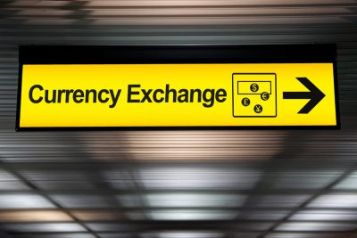 Currency exchange sign at airport