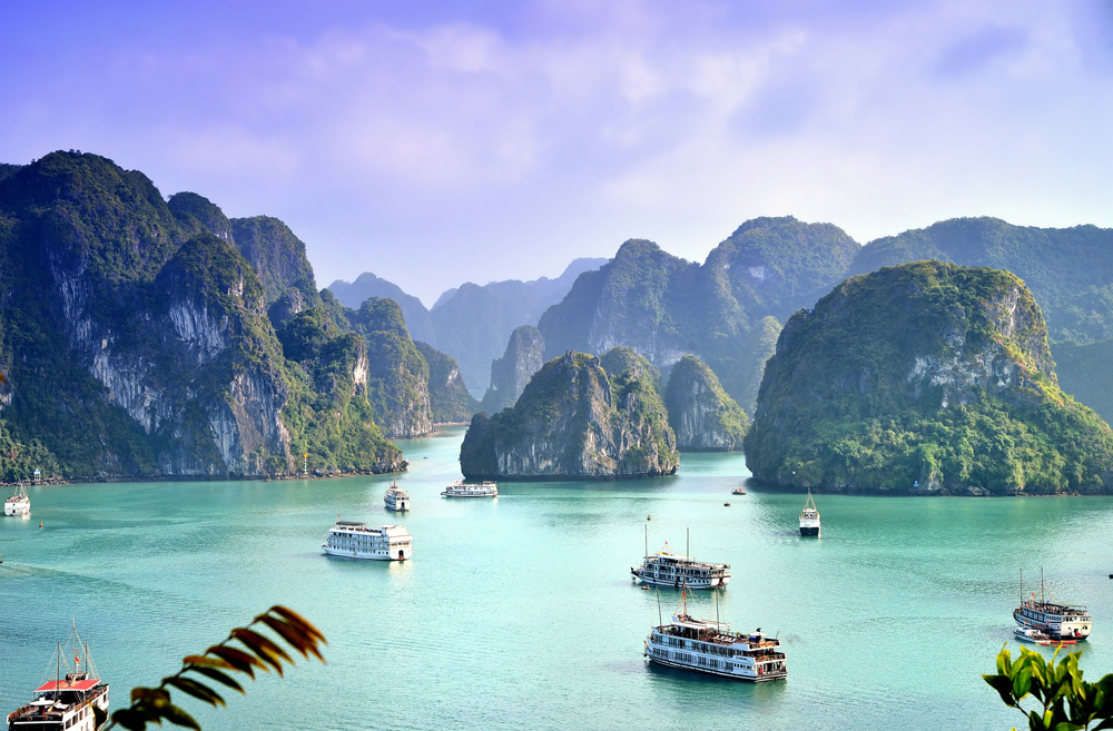 Karst landforms and boats in Halong Bay, Vietnam