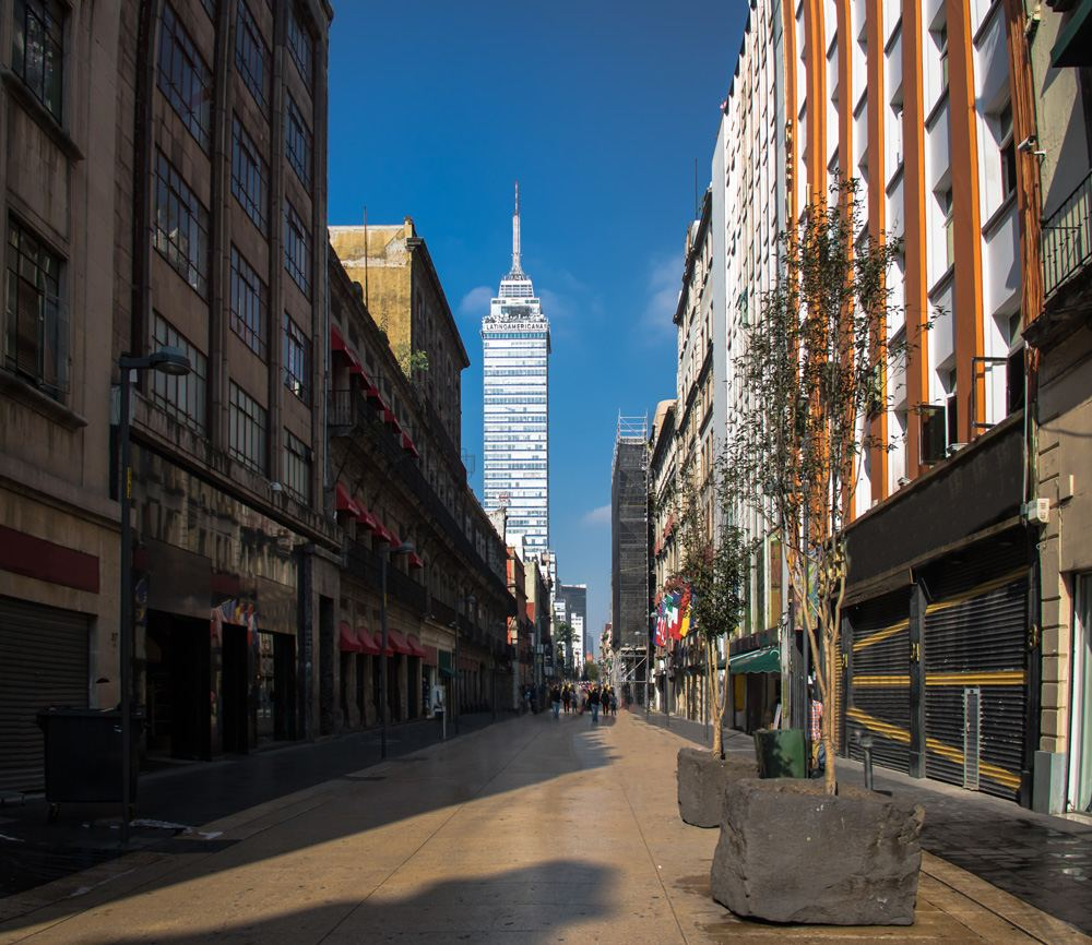 Pedestrian street downtown with Torre Latinoamericana in background, Mexico City, Mexico