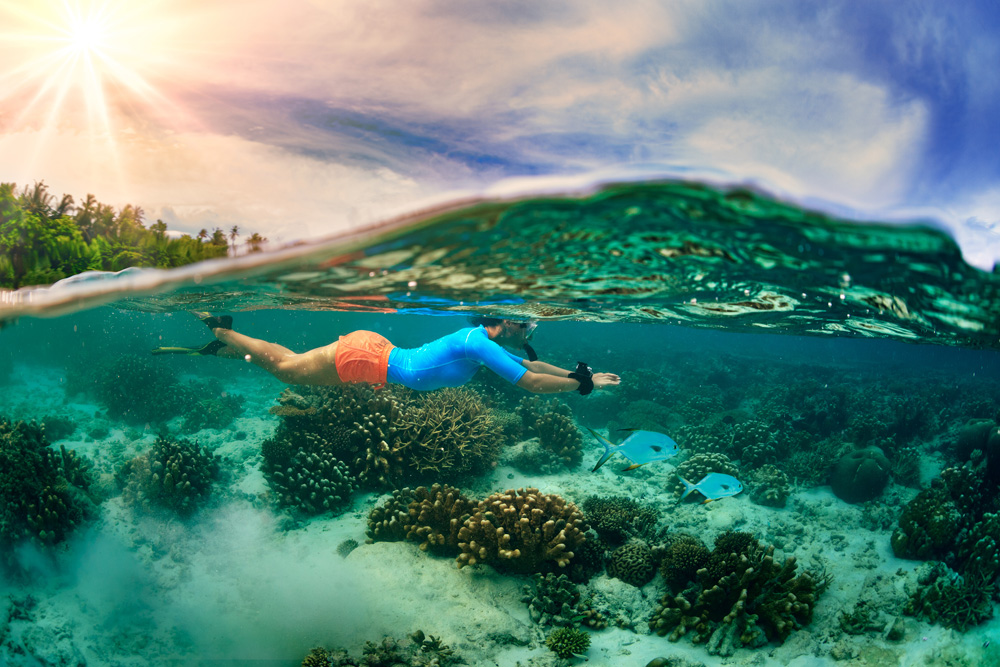 Swimming in tropical waters of the Maldives