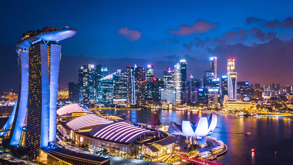 Aerial view of Singapore skyline at night near Marina Bay, Singapore