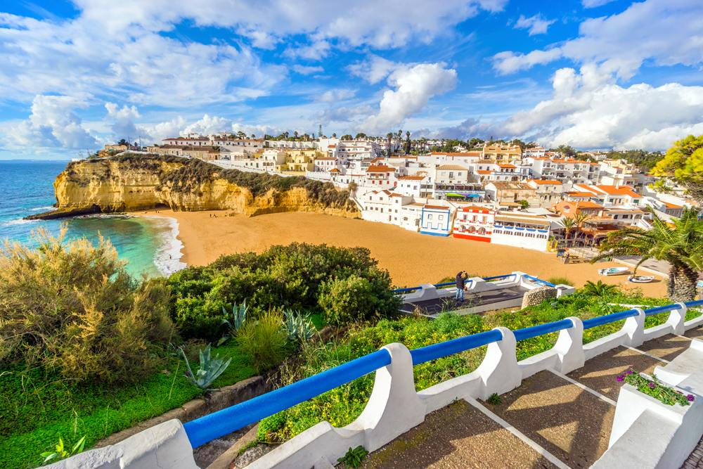 Beautiful beach, cliffs and stairs in colourful Carvoeiro, Algarve, Portugal