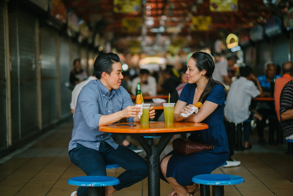 Enjoying a snack at a hawker centre, Singapore