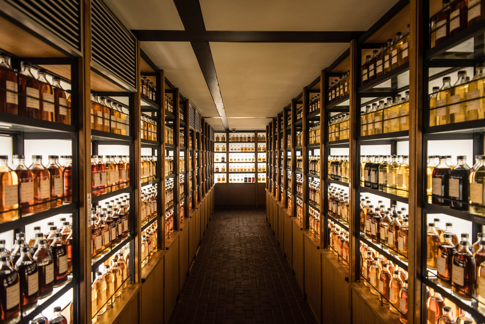 Room full of whisky cabinets storing different types of whisky