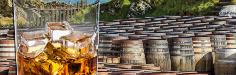 Scotch glass and whisky barrels lined up seaside on the Island of Islay, Scotland UK (United Kingdom)
