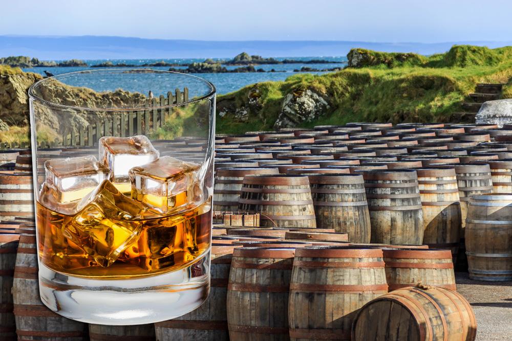 Scotch glass and whisky barrels lined up seaside on the Island of Islay, Scotland UK (United Kingdom)