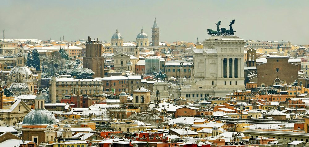 Skyline of snow covered Rome in winter, Italy