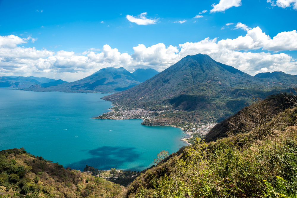 Viewpoint at Lake Atitlan with San Pedro, Atitlan and Toliman volcanos and San Pedro and San Juan villages, Guatemala