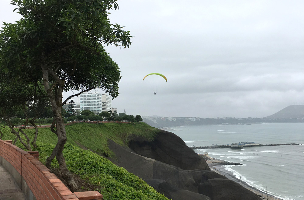 Aren Bergstrom - Paragliding Off Cliffs of Miraflores, Lima, Peru - Cropped
