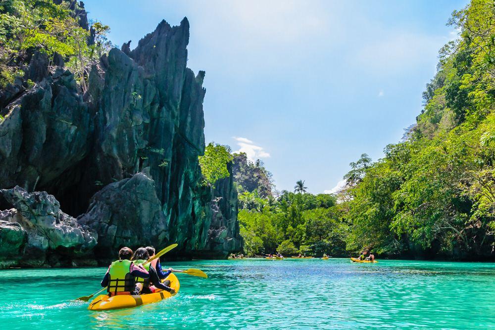 Kayaks in the big lagoon, El Nido, Palawan, Philippines