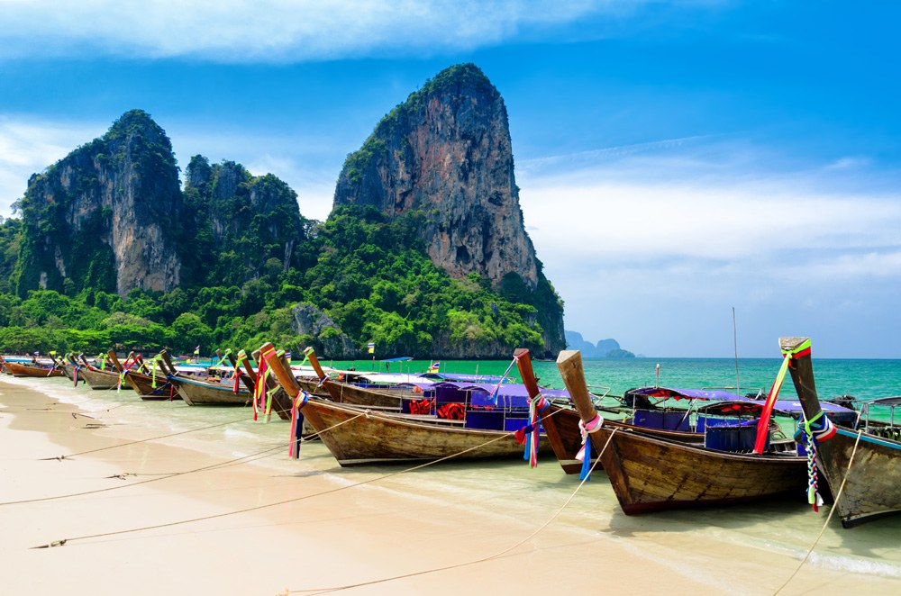 Traditional Thai boats on a beach in Krabi, Thailand