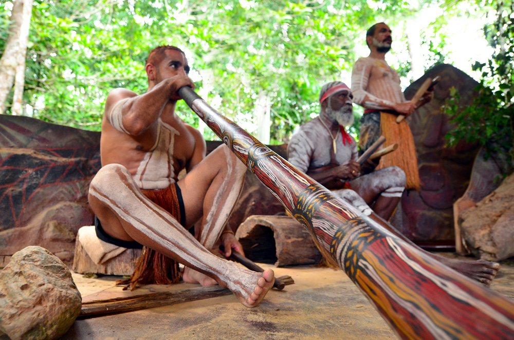 Yirrganydji Aboriginal men play didgeridoo and wooden instrument at culture show, Queensland, Australia