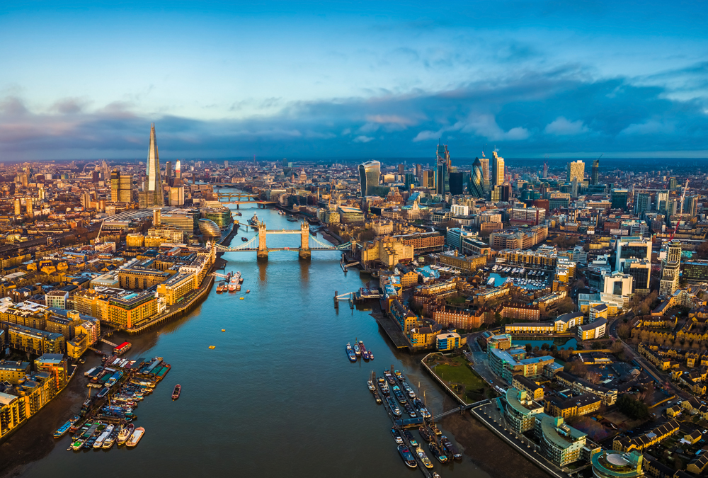 Aerial skyline view of London along the Thames at sunset, England UK United Kingdom