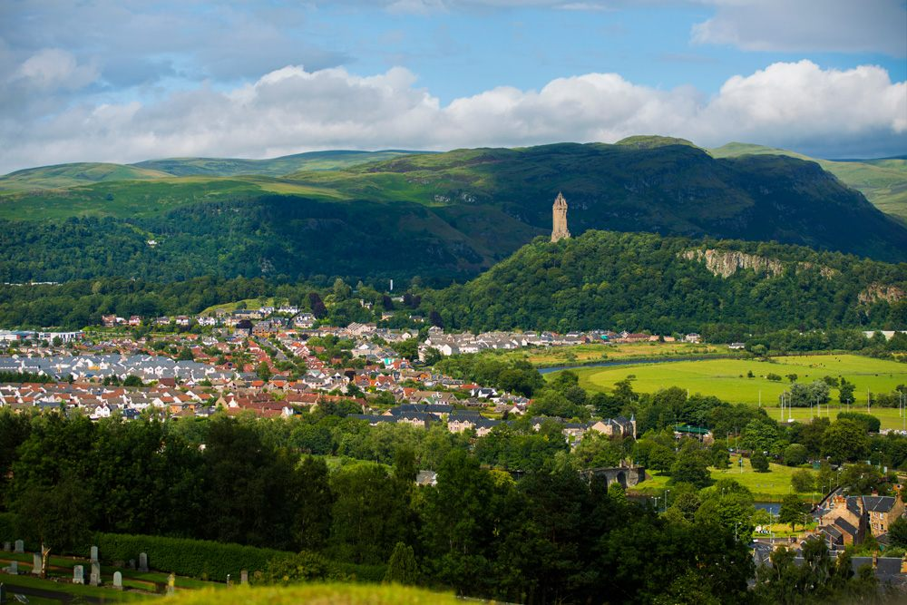 Aerial view of Stirling with the William Wallace Monument in the distance, Scotland