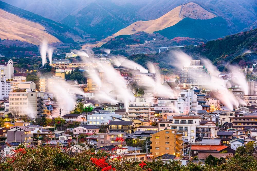 Beppu cityscape with rising steam from hot spring bathhouses, Beppu, Japan