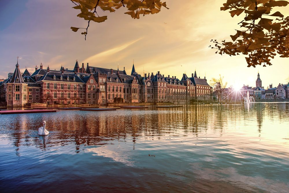 Binnenhof building and The Hague city reflected on the pond, Netherlands