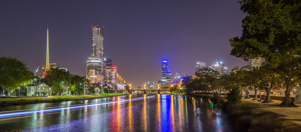 Eureka Tower and Art Centre across Yarra River at night, Melbourne, Australia