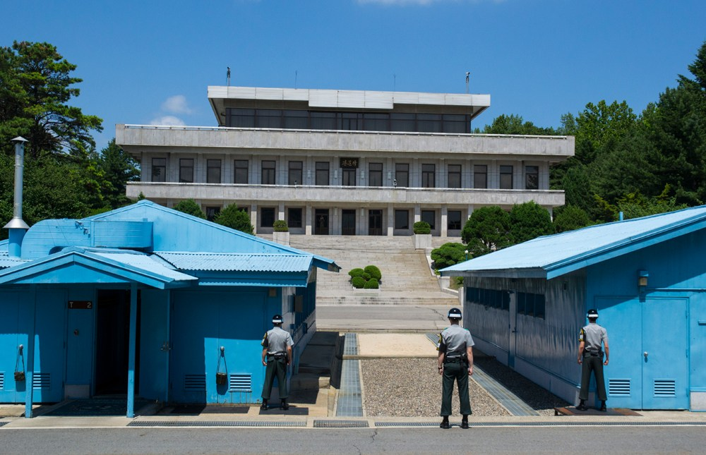 Guards looking across the border at North Korea in the Demilitarized Zone (DMZ) between North and South Korea
