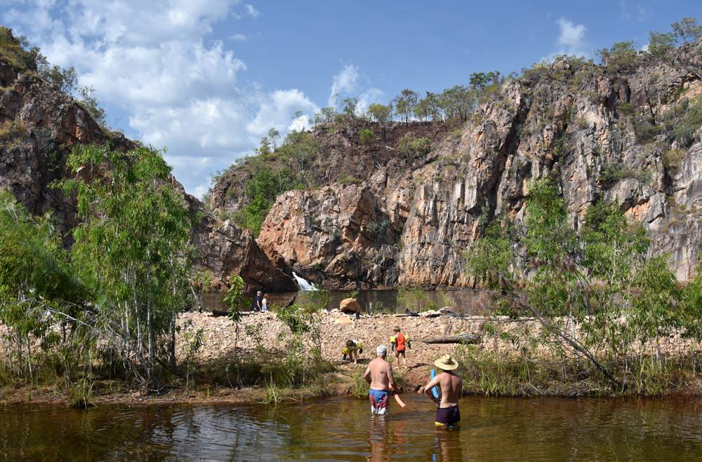 People swimming in the waterhole at Edith Falls, on the Edith River in Nitmiluk National Park, Australia