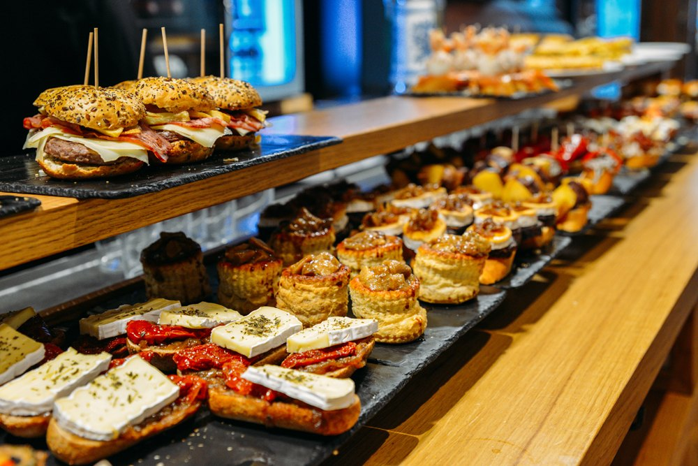 Pintxos served on a bar counter in a restaurant in San Sebastian, Spain