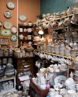 Shop selling vintage tea cups and sets at Camden Passage antiques market, Islington, London, England, UK United Kingdom