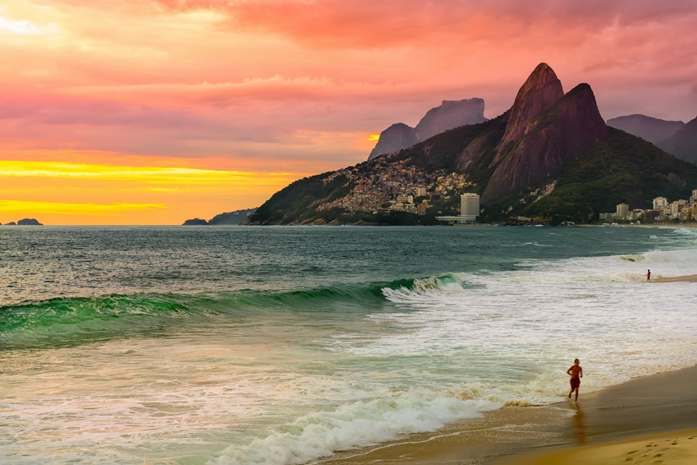 Sunset view of Ipanema beach and mountain Dois Irmao (Two Brothers) in Rio de Janeiro, Brazil