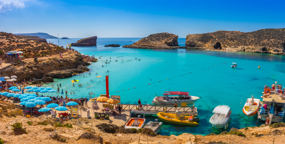 Tourists at Blue Lagoon enjoying the beach, Comino Island, Malta