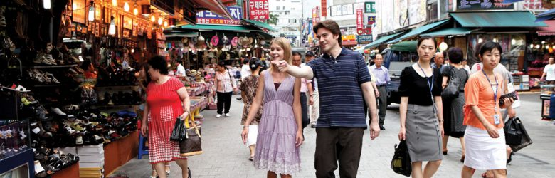Tourists walking through Namdaemun Market in Seoul, Korea