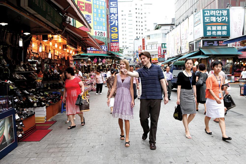 Tourists walking through Namdaemun Market in Seoul, Korea