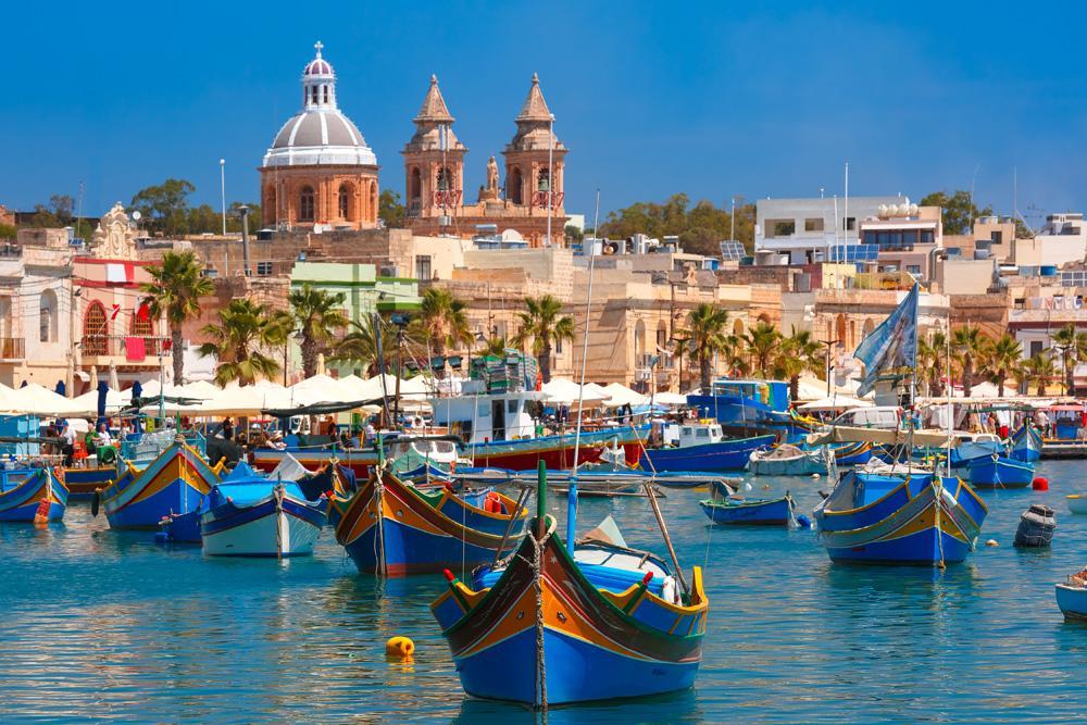 Traditional Luzzu boats in Marsaxlokk fishing village, Malta