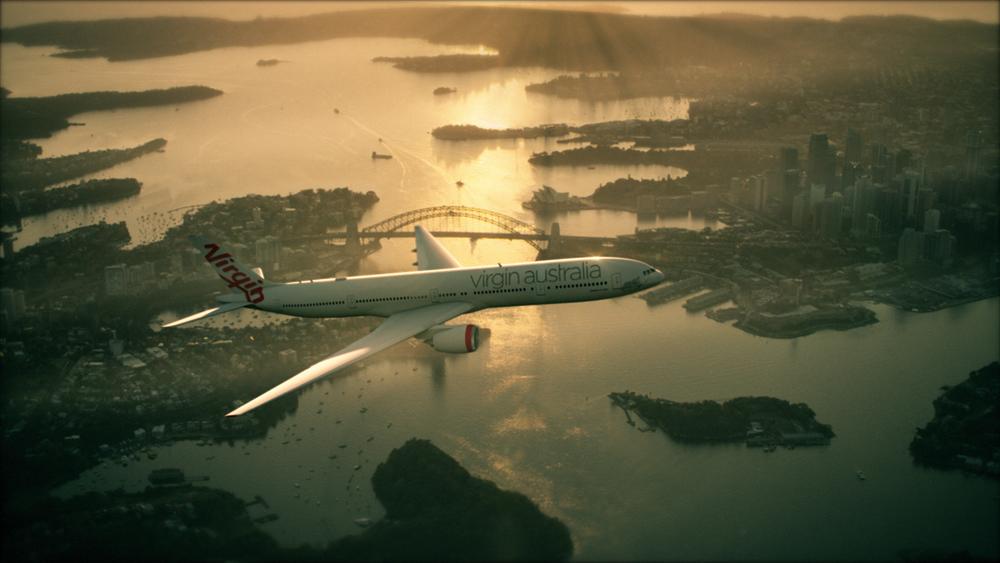 Virgin Australia 777 aircraft flying over Sydney Harbour, Sydney, Australia