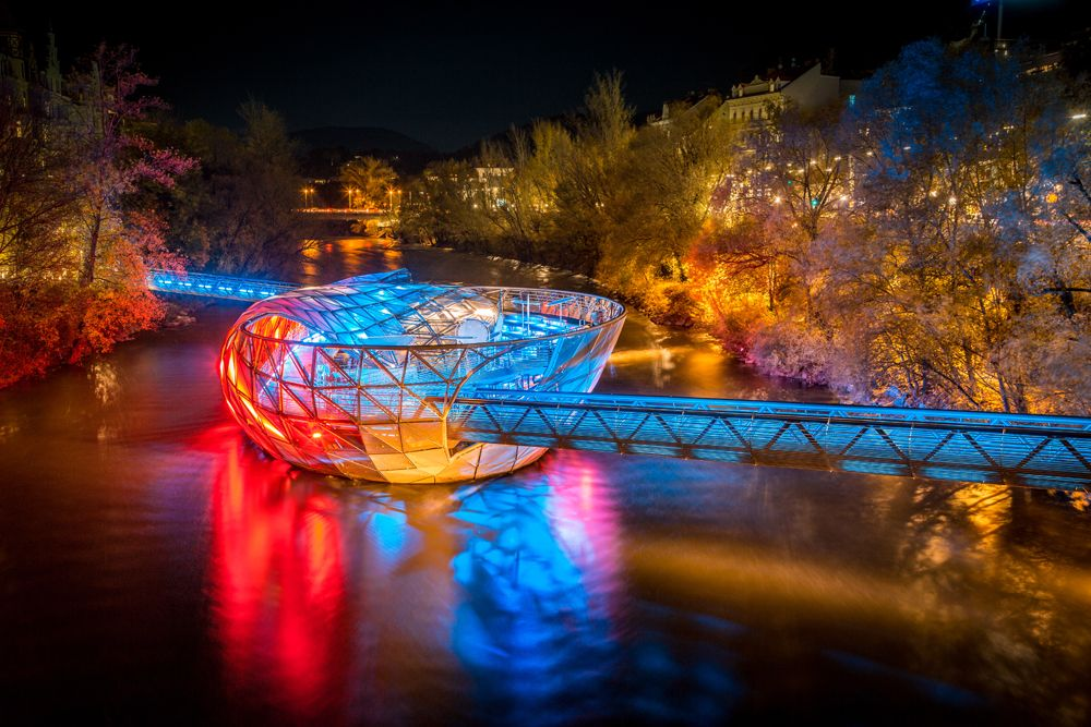 Grazer Murinsel on Mur River illuminated at night, Graz, Austria