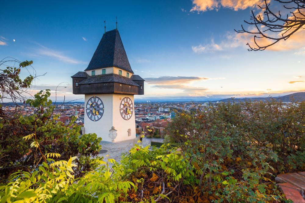 Grazer Uhrturm clock tower on a beautiful evening, Graz, Austria