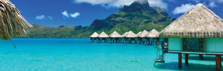Overwater bungalows of a luxury resort providing a view of the Otemanu, Bora Bora, Tahiti, French Polynesia