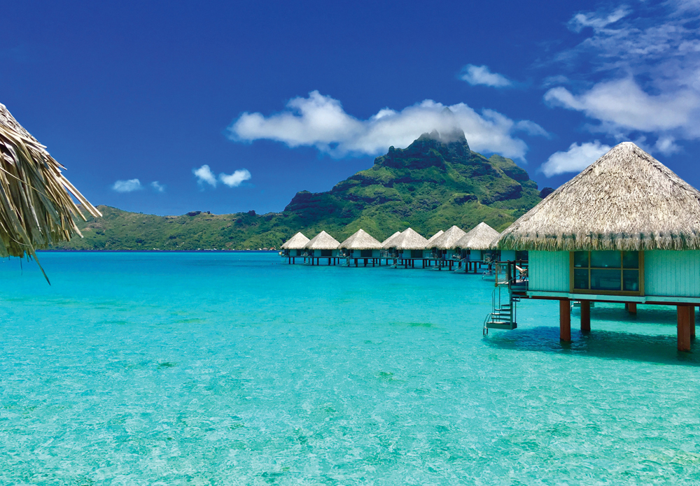 Overwater bungalows of a luxury resort providing a view of the Otemanu, Bora Bora, Tahiti, French Polynesia