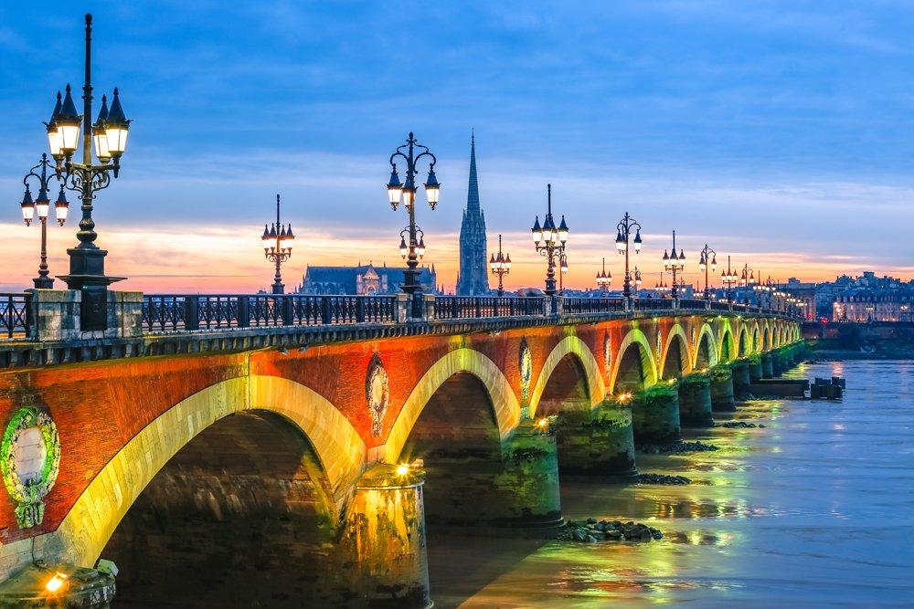 Pont de Pierre stone bridge at sunset in Bordeaux, France