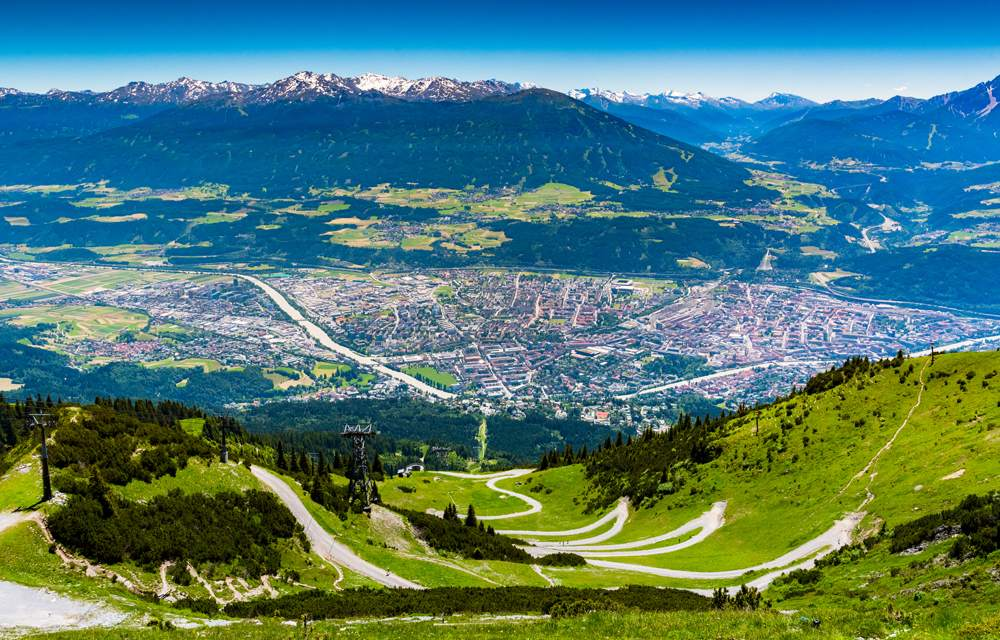 View of Innsbruck city with the Alps mountain range and cable car taken from Nordkette mountain, Austria