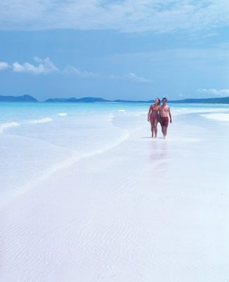 Walking along Whitehaven Beach in the Whitsundays, Queensland, Australia